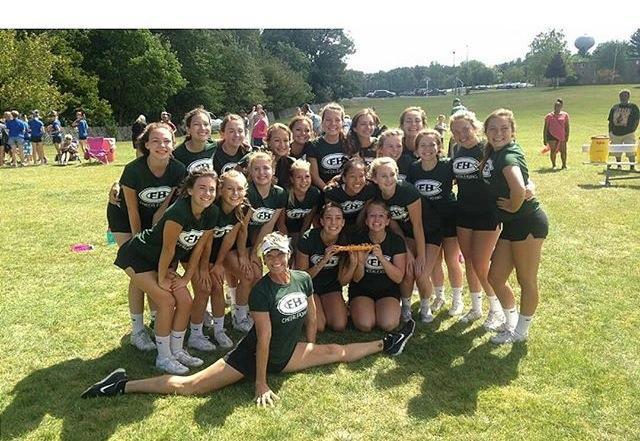 The cheer team celebrates winning the spirit stick.