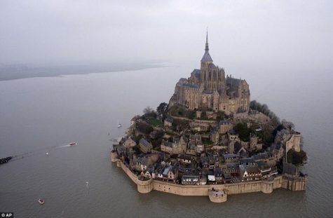 Le Mont-Saint-Michel is in Normandy, France. Le Mont Saint Michel is not just a church on a rock; it is a whole medieval city, one of the few places in France to have preserved intact its medieval walls and defenses.