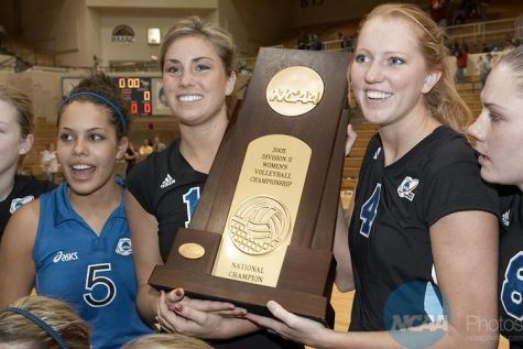 03 DEC 2005: Alyson Riley (5), Lauren Hanson (16), Tracy Kirk (4) and Tina Tromblay (8) of Grand Valley State, Allendale, MI hold the trophy after the Division II Women's Volleyball Championship held at the Health and Sports Center in Kearney, NE. Grand Valley State defeated the University of Nebraska- Kearney 3-1 to win the national title. Scott Anderson/NCAA Photos