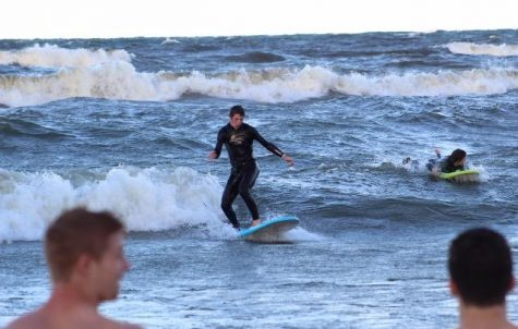 Senior Mark Scannell catches a wave in Grand Haven.