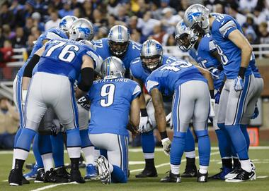 Detroit Lions quarterback Matthew Stafford (9) calls a play against the Atlanta Falcons during an NFL football game at Ford Field in Detroit, Saturday, Dec. 22, 2012. (AP Photo/Rick Osentoski)
