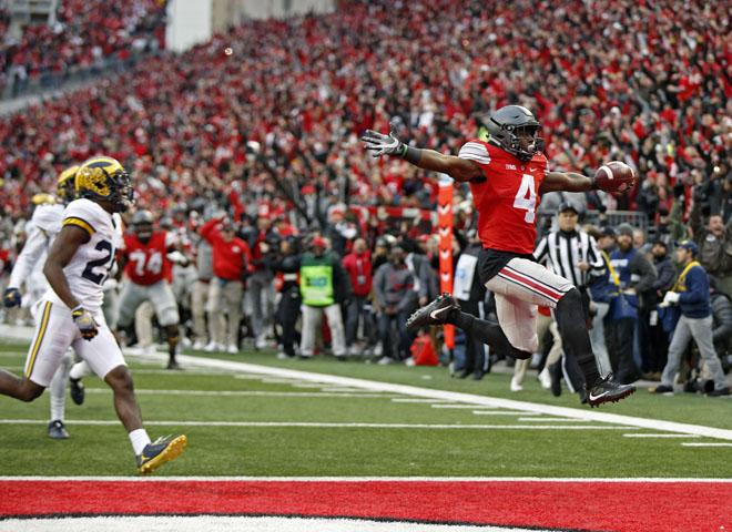 Ohio+State+Buckeyes+running+back+Curtis+Samuel+%284%29+jumps+into+a+the+end+zone+for+the+game+winning+touchdown+in+a+double+overtime+win+over+Michigan+Wolverines+touchdown+at+Ohio+Stadium+in+Columbus%2C+Ohio+on+November+26%2C+2016.++%28Kyle+Robertson+%2F+The+Columbus+Dispatch%29