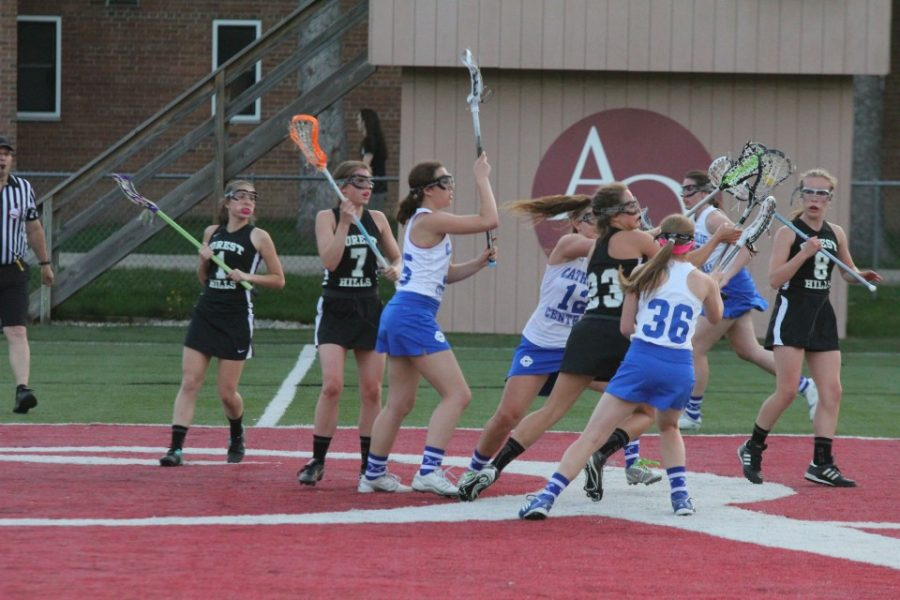 Varsity girls lacrosse battles against Catholic Central