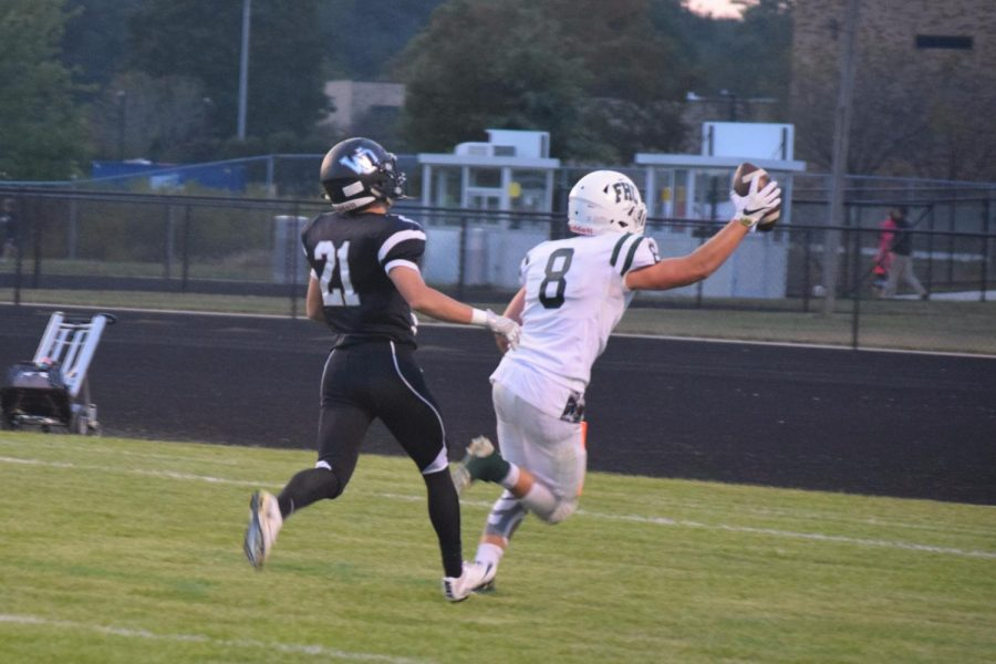 Varsity football completes incredible fourth quarter drive to beat West Ottawa 30-27