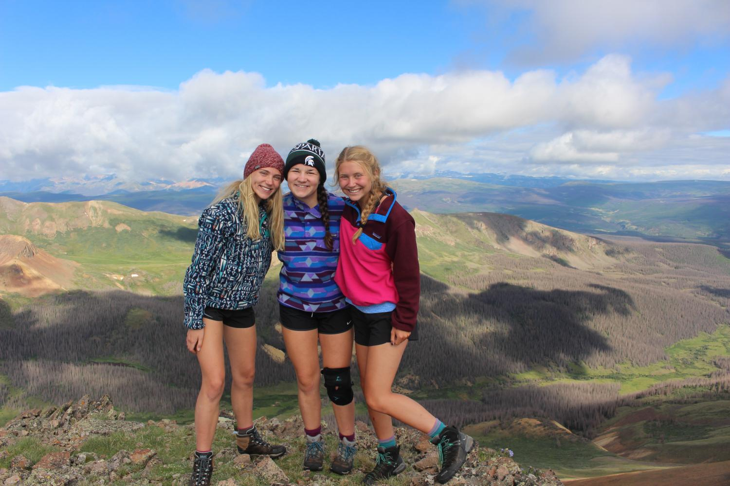 A group of senior girls overcome obstacles and climb a mountain