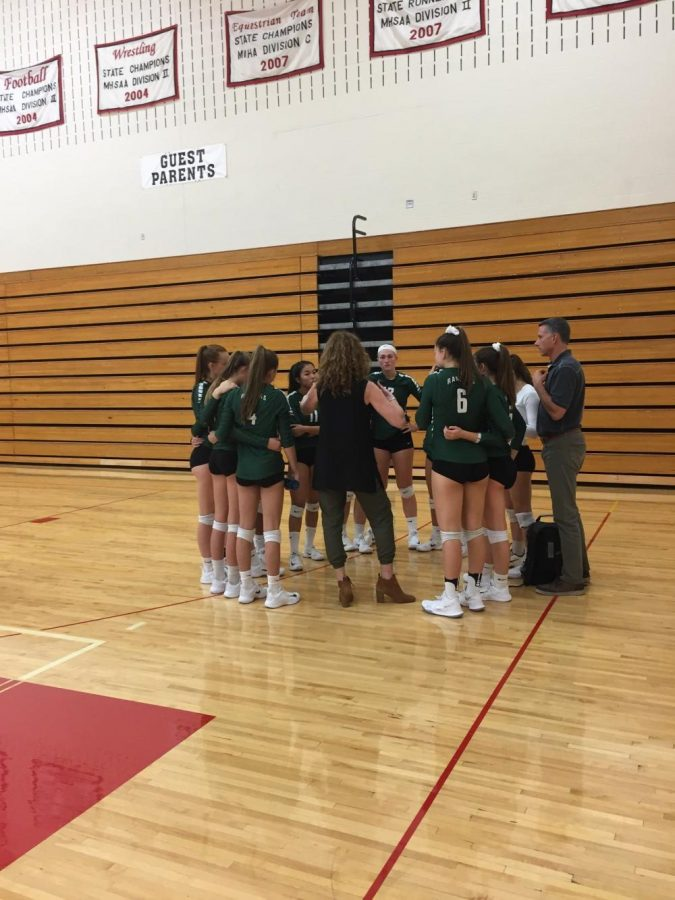 Varsity volleyball is defeated by Lowell in three