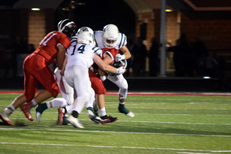 Varsity football captures OK white title after beating Cedar Springs 35-20