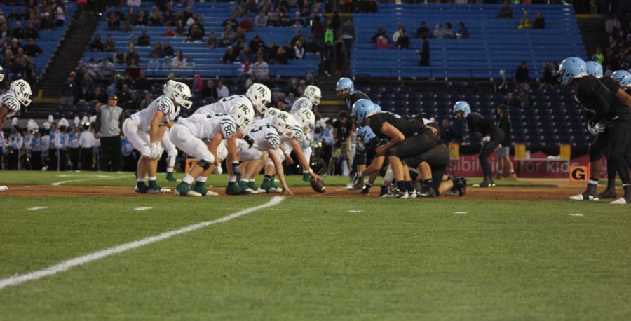 Varsity+football+clinches+a+playoff+berth+after+beating+FHN+31-14