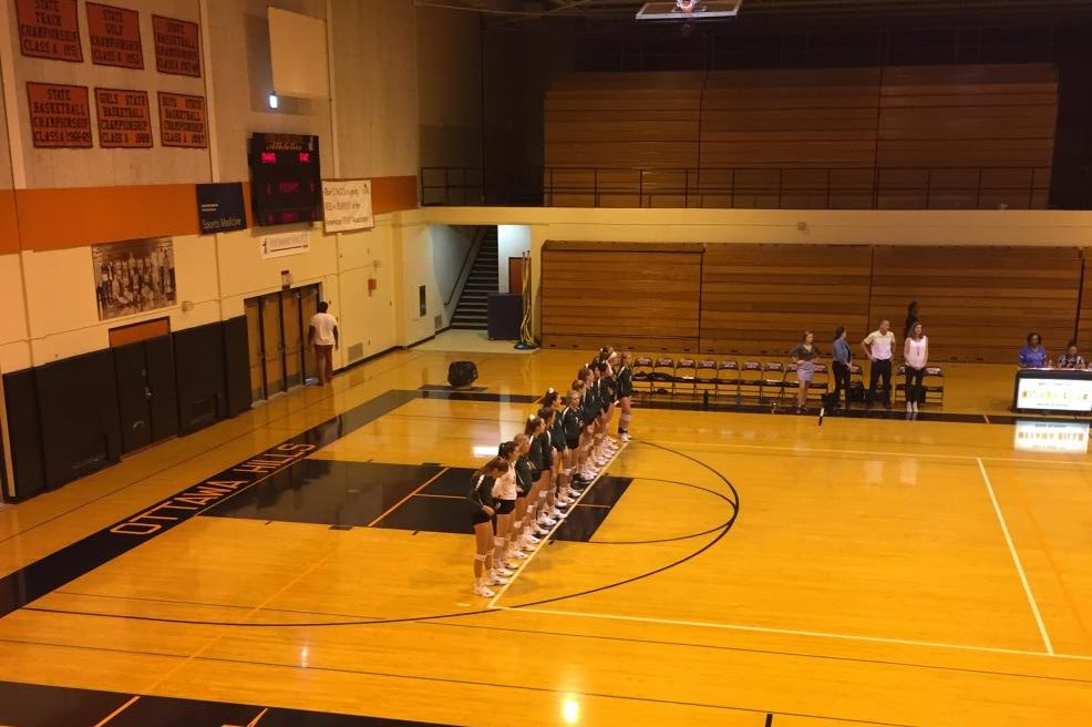 Varsity volleyball defeats Ottawa Hills in three