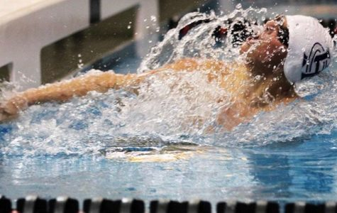 Boys swim and dive take home a sweet victory against East Kentwood 177-138