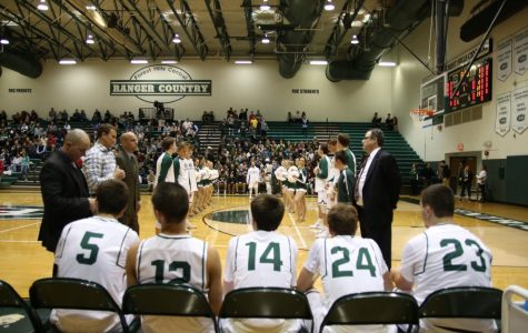 Boys varsity basketball suffers a tough opening loss to East Kentwood 68-66