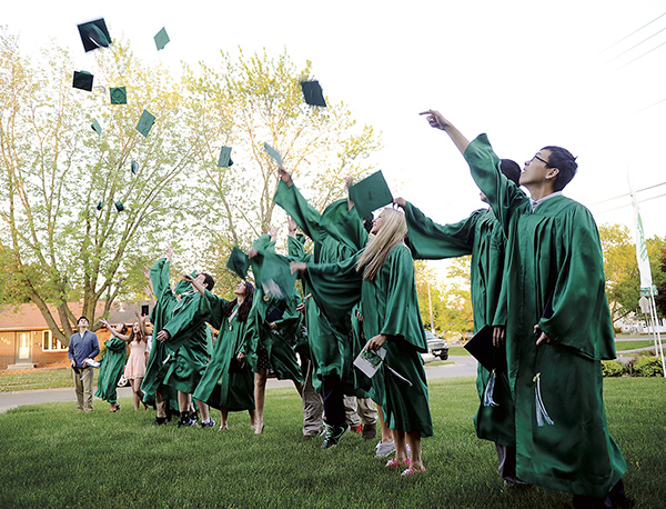 Pacelli graduates throw their caps in the air after commencement Wednesday night at St. Edwards Catholic Church. Eric Johnson/photodesk@austindailyherald.com
