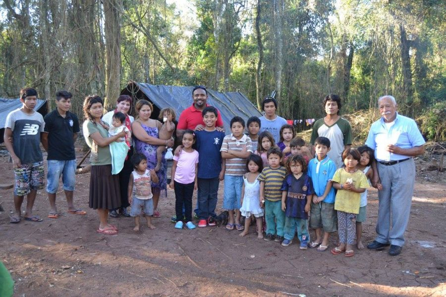 Silvestre and his children (pictured center) posing with the Argentinians they helped out