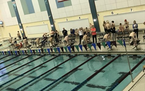 Boys Swim and Dive takes home another victory against Grand Rapids Catholic Central