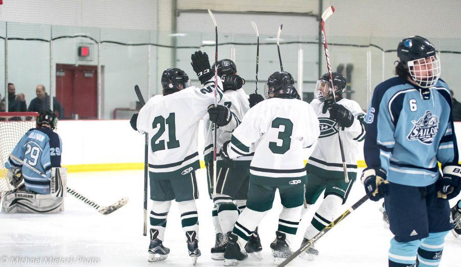Boys Varsity Hockey edges out Mona Shores 4-3