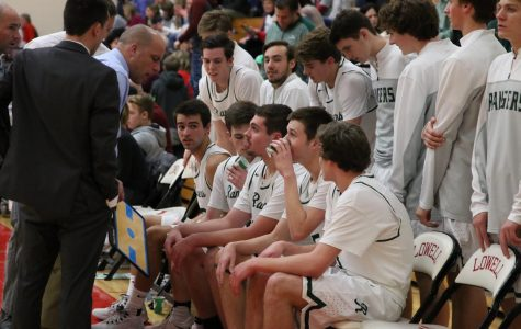 Boys varsity basketball clinches OK white after big win over Lowell 66-44