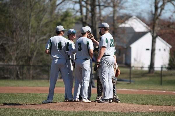Varsity baseball splits with West Ottawa