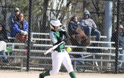Varsity softball splits in a non-conference doubleheader with Mona Shores