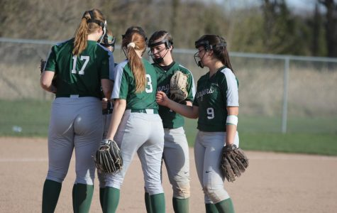 Girls varsity softball completes the season sweep of Cedar Springs 9-3