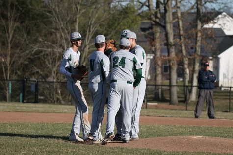Varsity baseball rolls past Lowell for two conference wins