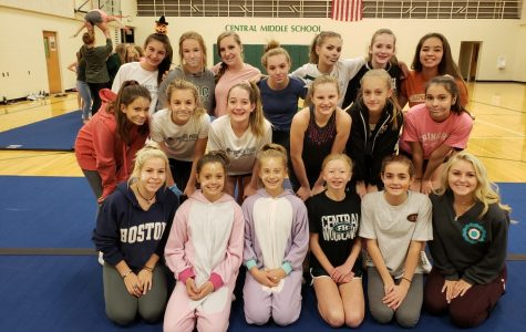 Varsity cheerleaders coach and inspire the youth cheer program