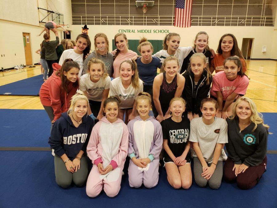 Varsity cheerleaders coach and inspire the youth cheer program