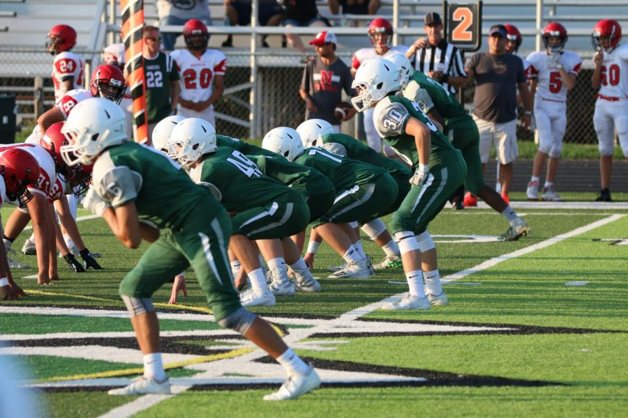 JV football blows out rival Lowell 33-8