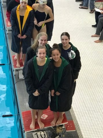 Girls Swim and Dive secures at least second place in the conference