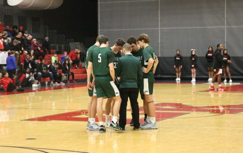 Boys varsity basketball earns first victory under Carhart, 52-38