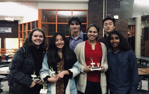 Armed with trophies and confidence, the accomplished debate team prepares for future tournaments