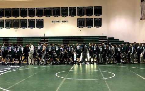 Varsity A wrestling goes 1-1 at Crossover duals