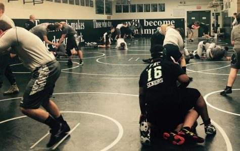 Varsity B wrestling starts season with high potential in round robin tournament