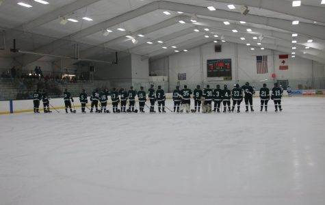 Varsity hockey narrowly defeats Mona Shores 3-2 with a late goal from Cole Munger
