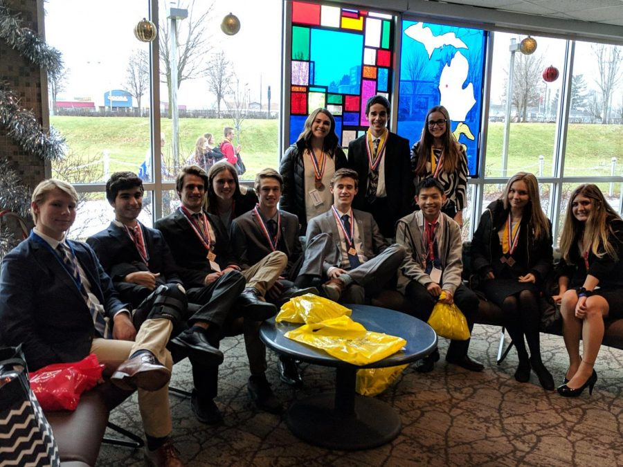 DECA dominates at districts through determination and dedication