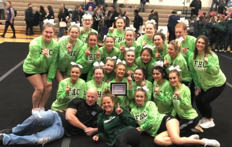 Competitive cheers earns fourth and first place at recent competitions