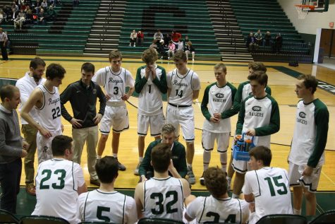 Boys varsity basketball drops season-opener to East Kentwood 75-58