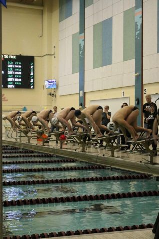 Boys swim and dive dominates against Grand Rapids Christian