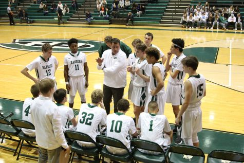 Tate Hallock leads boys varsity basketball to big win in season finale