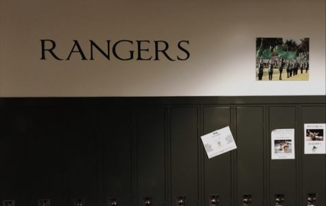 Ken George is giving positivity back to the school by selling hallway photographs