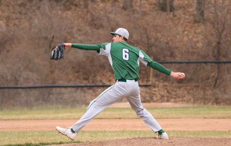 Varsity baseball splits doubleheader with Cedar Springs