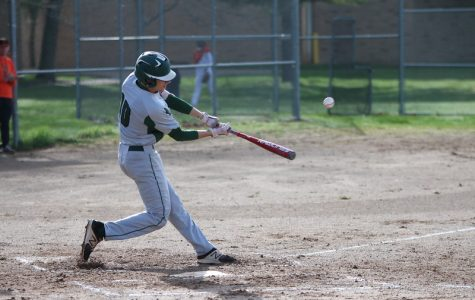 Varsity baseball splits with Lowell