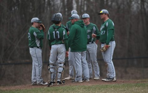 Varsity baseball splits with West Ottawa