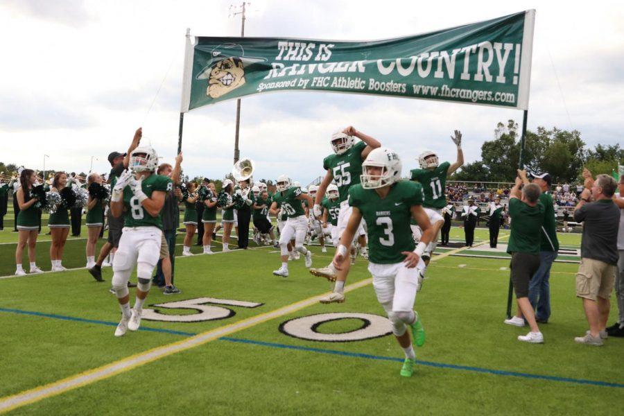 Varsity football takes down Jenison 14-7 in lightning-delayed season opener