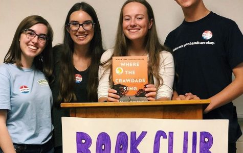 The four leaders at the first meeting presenting the first book: Where The Crawdads Sing by Delia Owens.