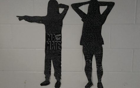 Through the creation of life-size silhouettes, students in Art Survey voice their concerns