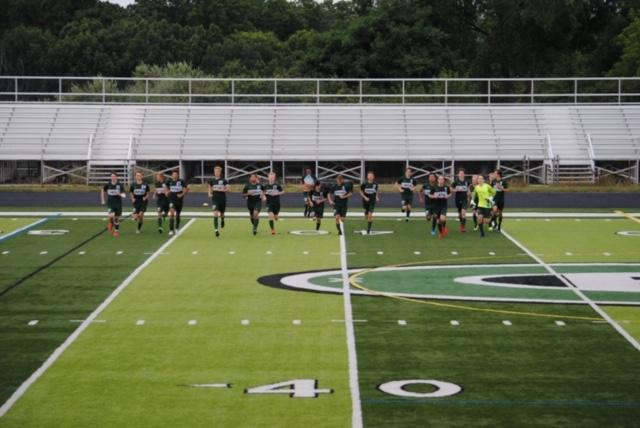 Sammy Postlewait's hat trick propels boys varsity soccer over Greenville 4-2