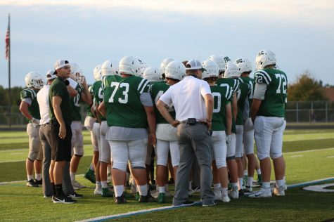 Varsity football battles through adversity to end season at 5-5