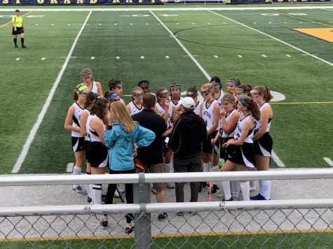Girls varsity field hockey loses final regular season game to the Ann Arbor Pioneers 7-0