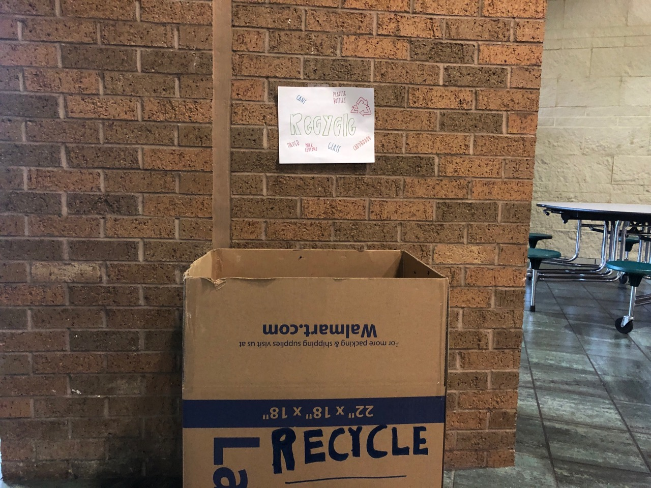 One of four homemade recycling bins made by members of the environmental club