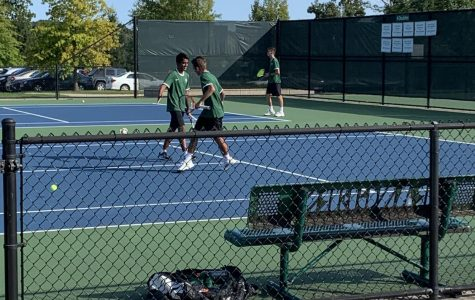 Nick Sjolin leads boys varsity tennis to 8-0 win against Greenville
